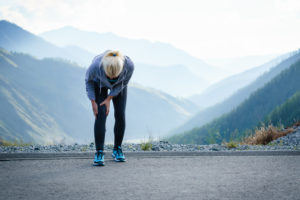 Photo of a runner with knee pain